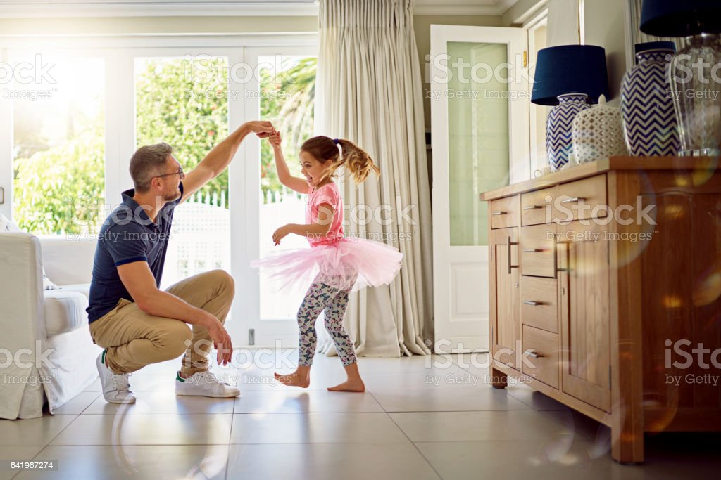 She'll never forget the day he taught her to dance stock photo