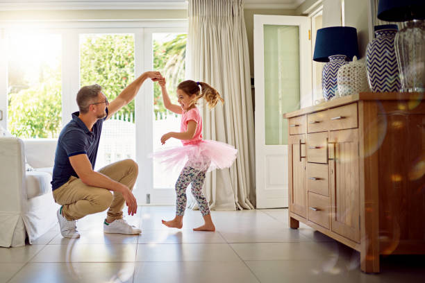 she'll never forget the day he taught her to dance - father and daughter stock photos and pictures