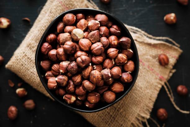 Shelled Hazelnuts on Black stock photo
