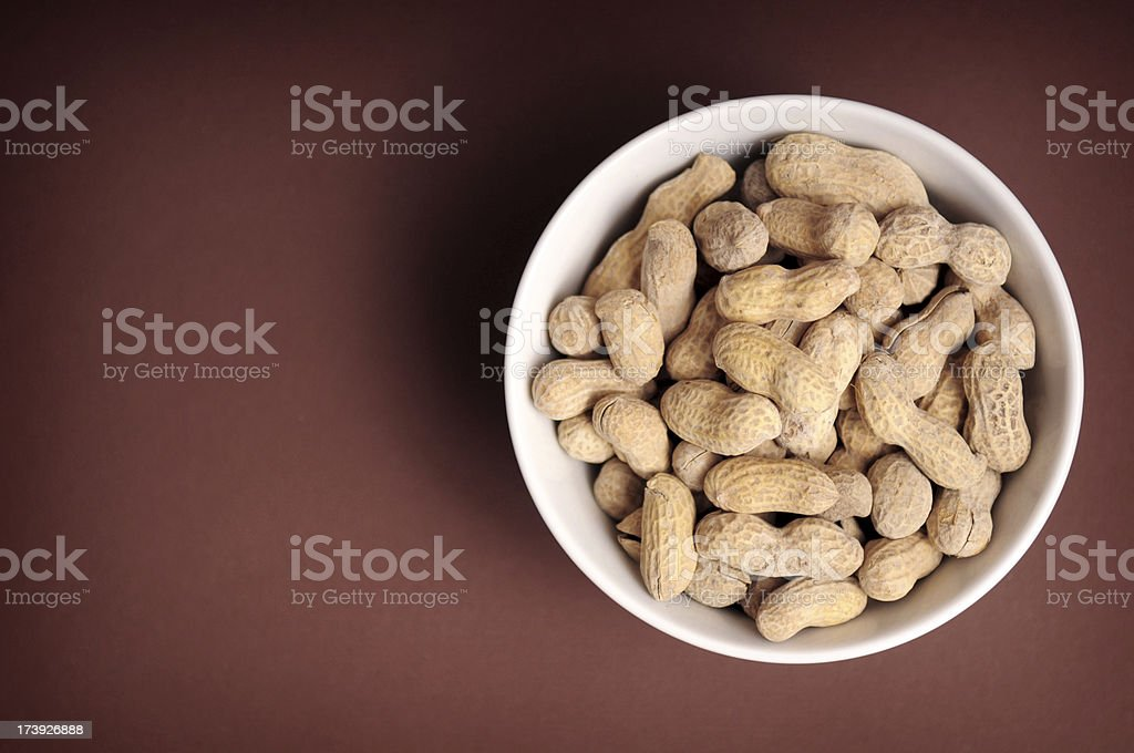 Shelled Peanuts in a Bowl royalty-free stock photo