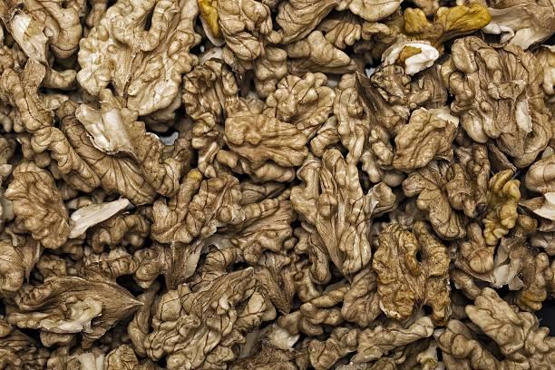 Shelled Walnuts background - high resolution, closeup image. stock photo