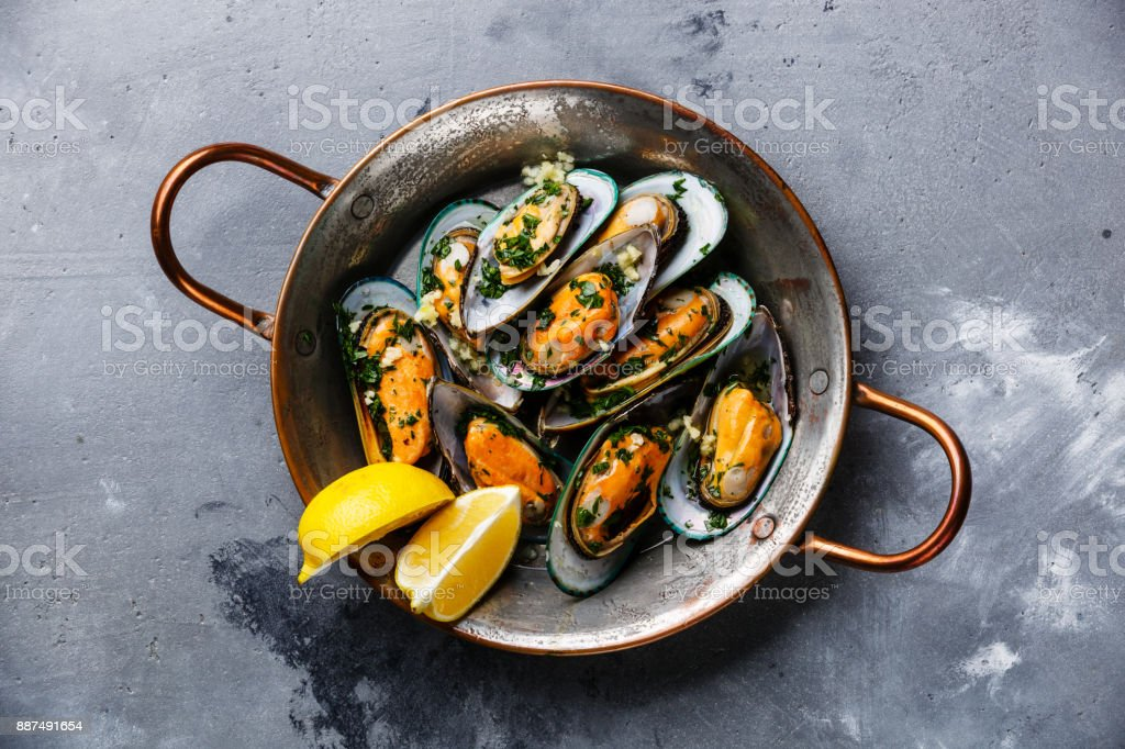 Shellfish Mussels Clams with parsley and lemon stock photo