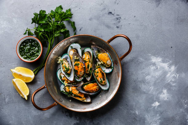 Shellfish Mussels Clams with parsley and lemon