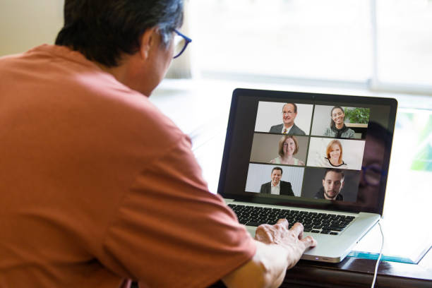 COVID-19 Shelter in Place and Social Distancing in effect, Virtual Business Working Group Working through Live Streaming, video Conferencing Virtual Office stock photo