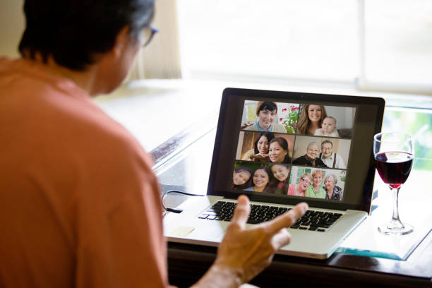 COVID-19 Shelter in Place and Social Distancing in effect, Virtual Social Life Continue through Live Streaming, video Conferencing Virtual Gathering stock photo
