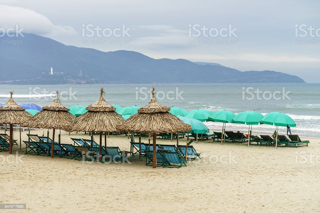 Shelters and sunbeds on China Beach in Da Nang stock photo