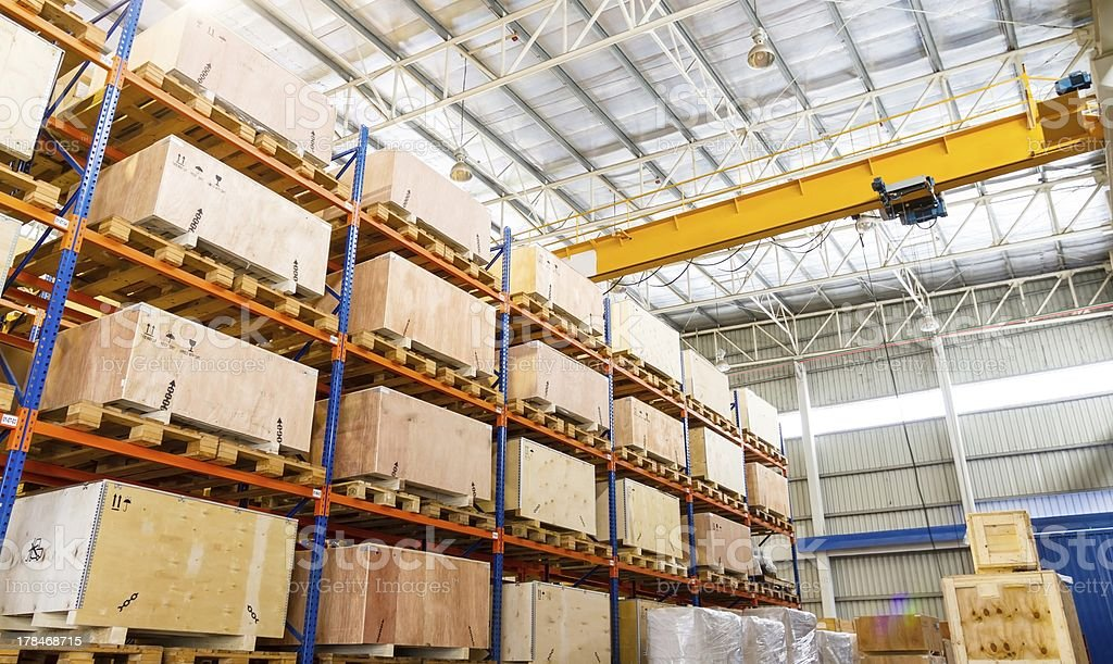 Shelves and racks in distribution warehouse interior stock photo