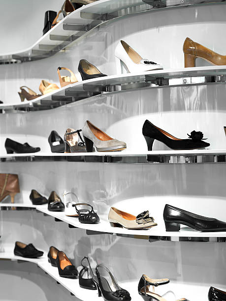 Shelves filled women shoes in a store stock photo