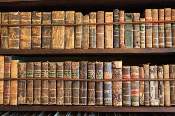 Shelves full of old books. stock photo