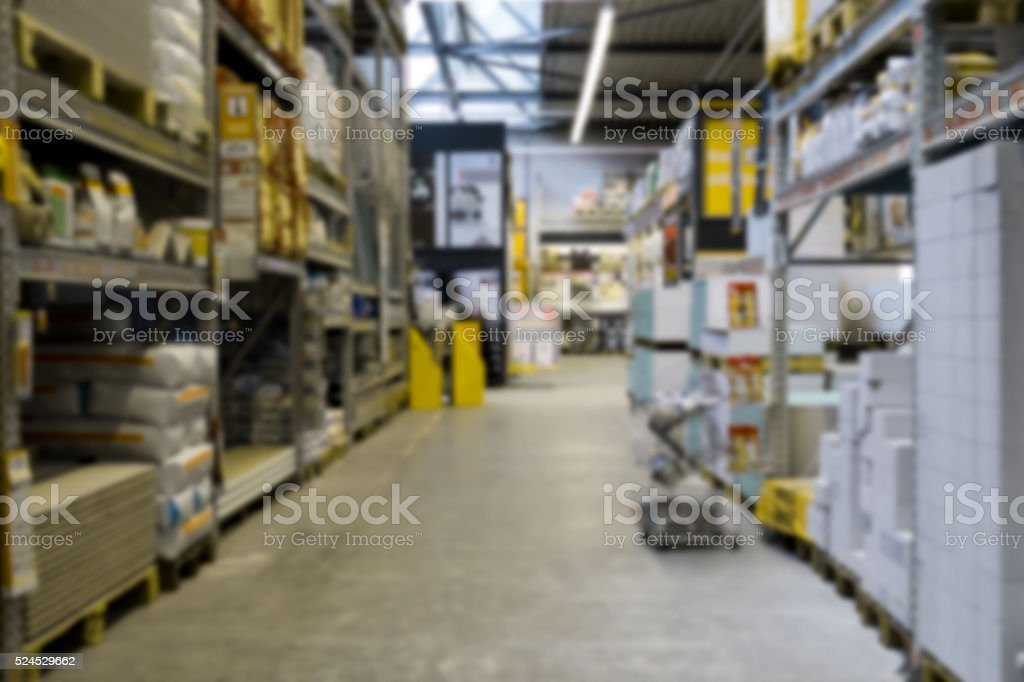 shelves in diy warehouse blurred stock photo