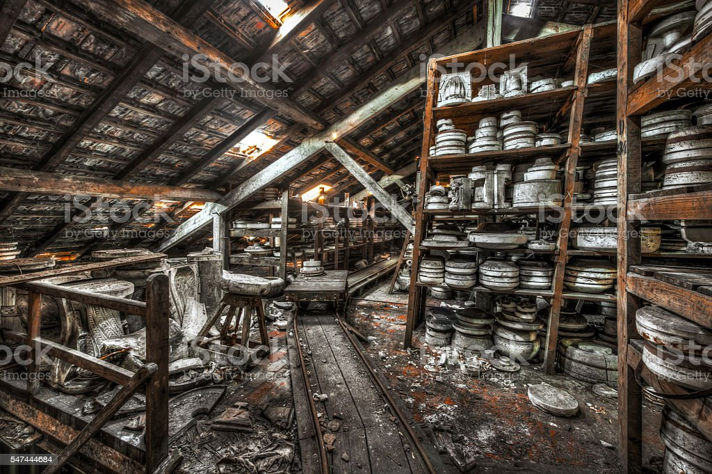 Shelves of clay moulds at an abandoned ceramics factory stock photo