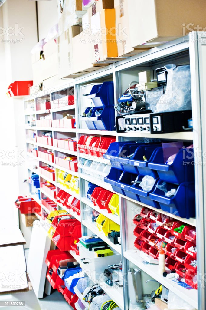Shelves Of Equipment And Components In Multicolour Boxes In A Laboratory royalty-free stock photo