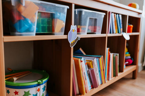 Shelves of toys and books in a nursery school stock photo