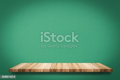 642100994istockphoto shelves on old concrete wall 628914014