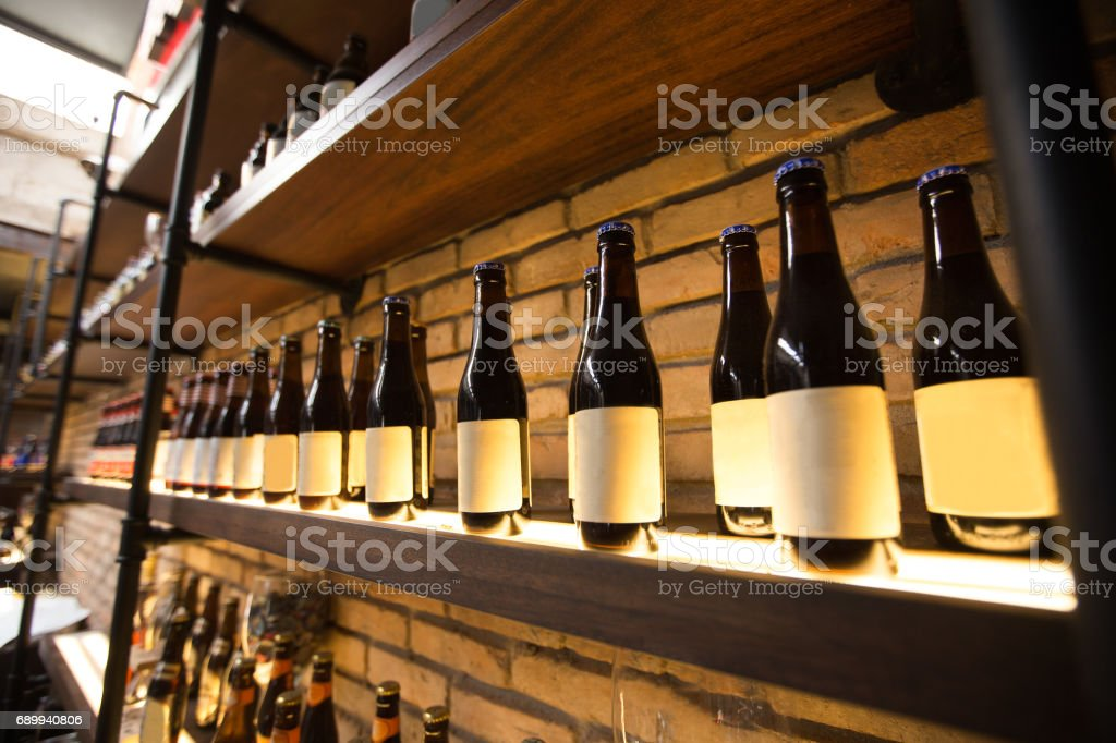 Closeup of shelves with bottles in pub