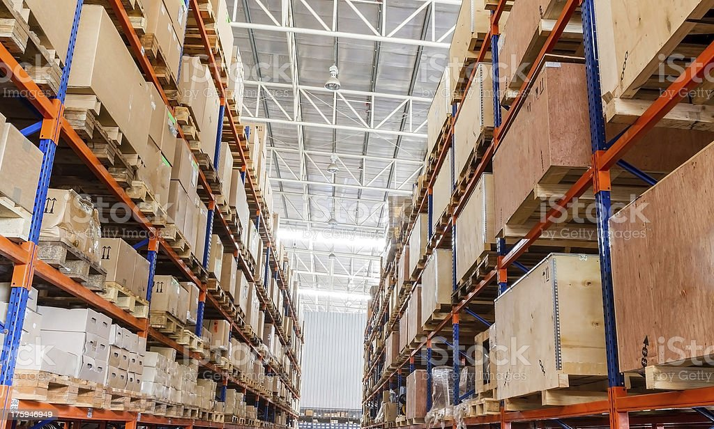 Shelves with boxes in factory warehouse stock photo