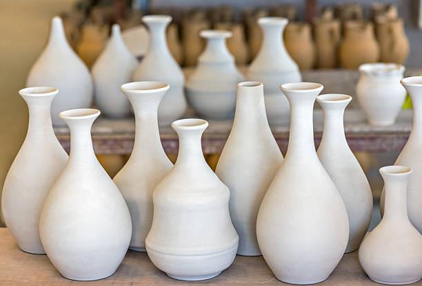 Shelves with ceramic dishware stock photo