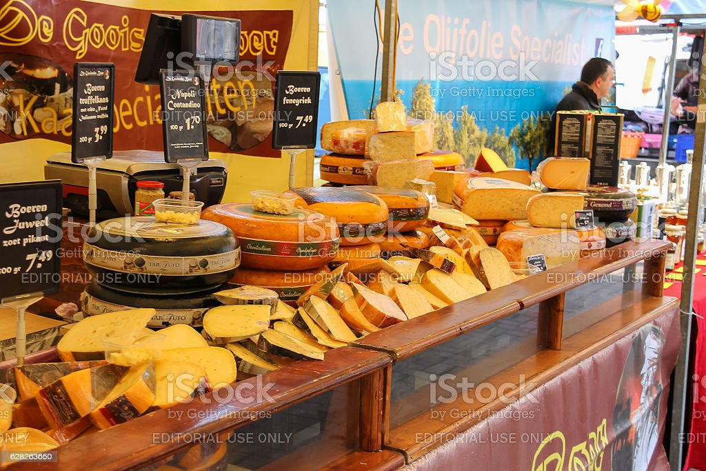 Shelves with famous Dutch cheese in the street market. stock photo
