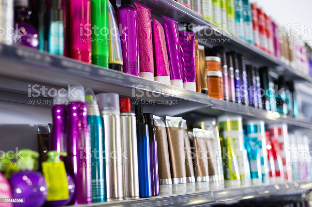 Shelves with hair care products in a cosmetics showroom indoor stock photo