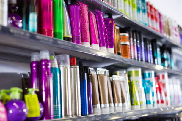 Shelves with hair care products in a cosmetics showroom indoor Shelves with fashionable hair care products in a cosmetics showroom indoor for sale stock pictures, royalty-free photos & images