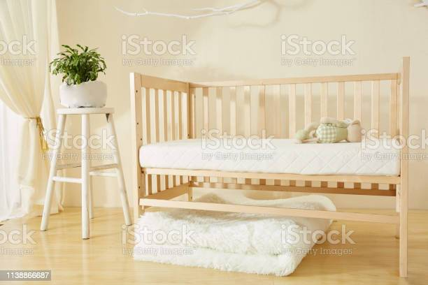 Photo of Shelves with hanger in modern baby room