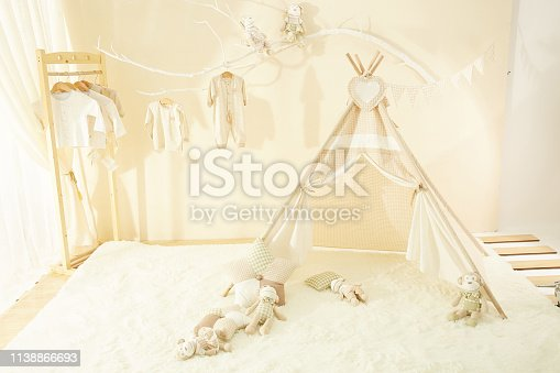 1061427386 istock photo Shelves with hanger in modern baby room 1138866693
