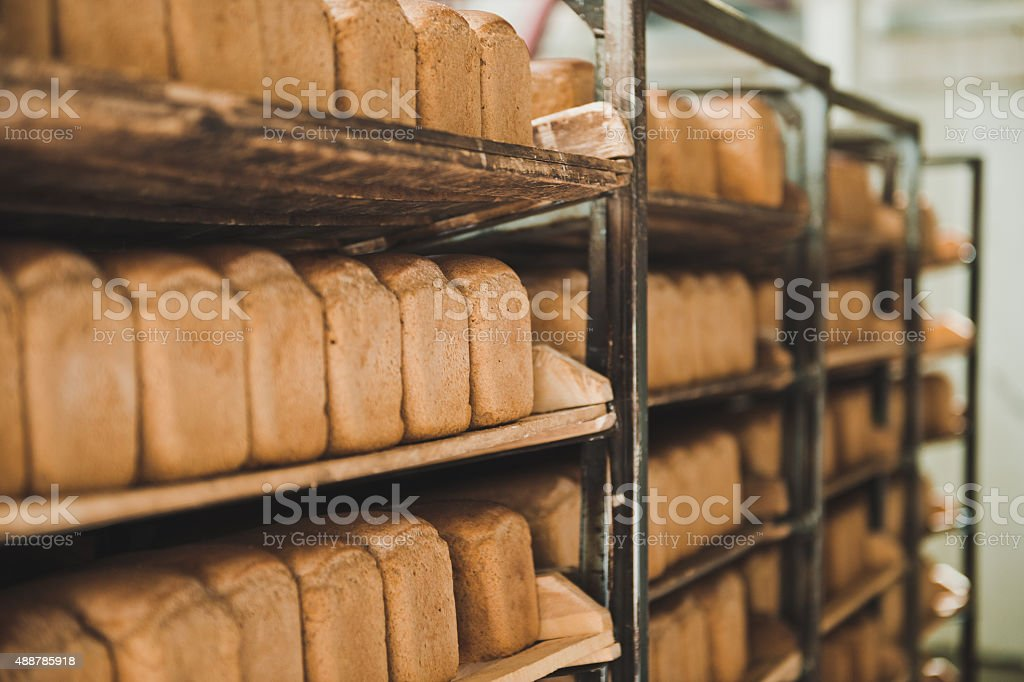 Shelves with loaves of bread stock photo
