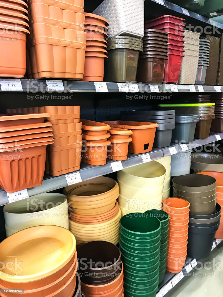 Shelves with pots for flowers of different colors in the shopping center ALL, Minsk, Belarus stock photo