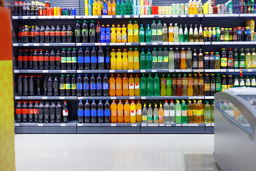 Shelves with variety refreshing of beverage for sale in the supermarket.