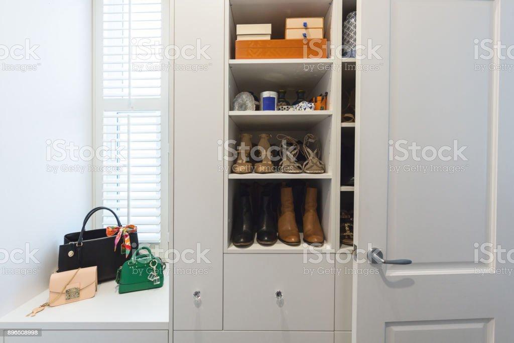 Shelving detail in a luxury walk in wardrobe stock photo