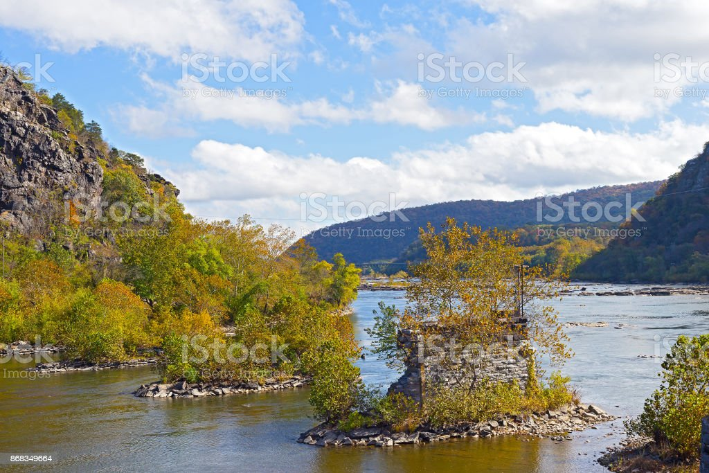 Shenandoah River with old bridge remains in Harpers Ferry, West Virginia, USA. stock photo