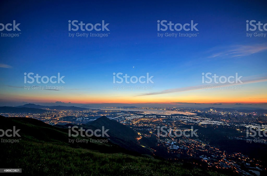 Shenzhen Bay with a Crescent Moon at Sunset stock photo