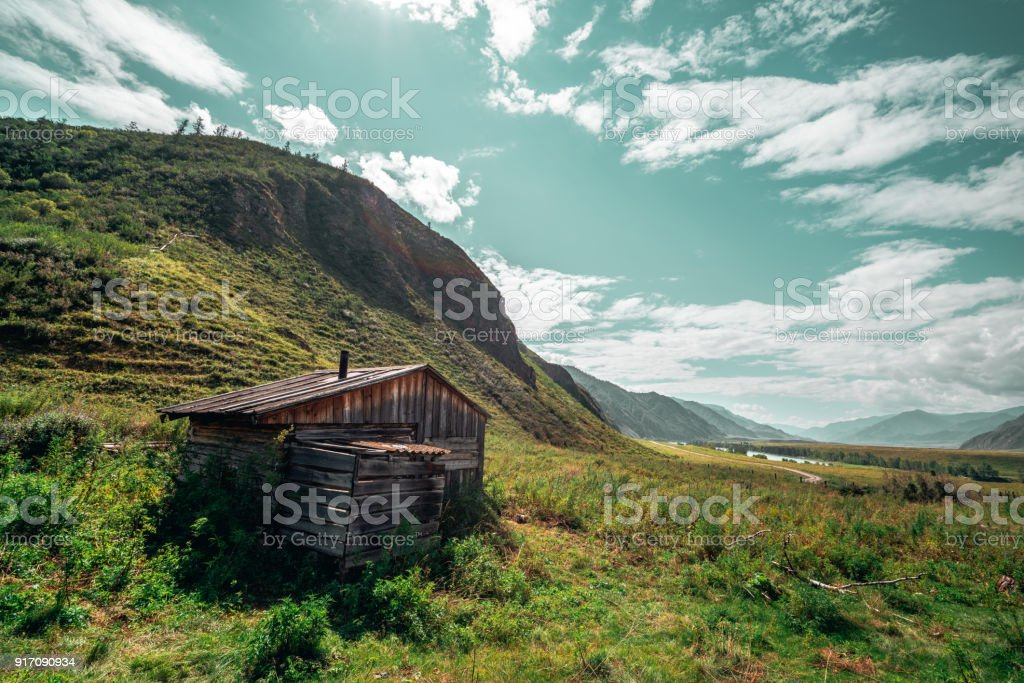 Shepherd's house surrounded by mountains stock photo
