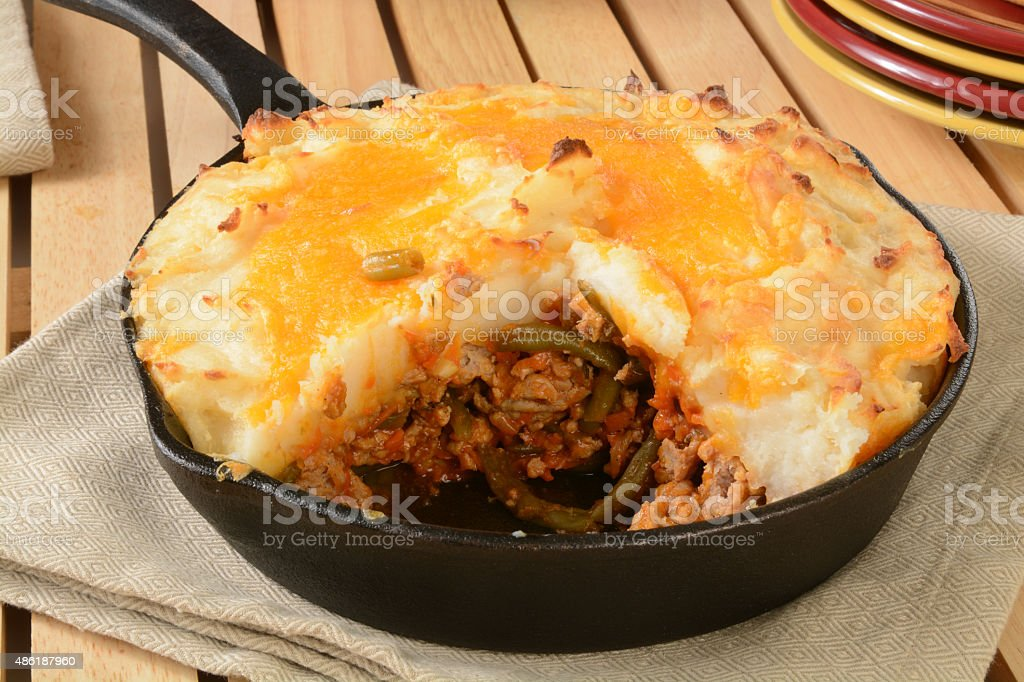 Shepherds pie in a cast iron skillet stock photo