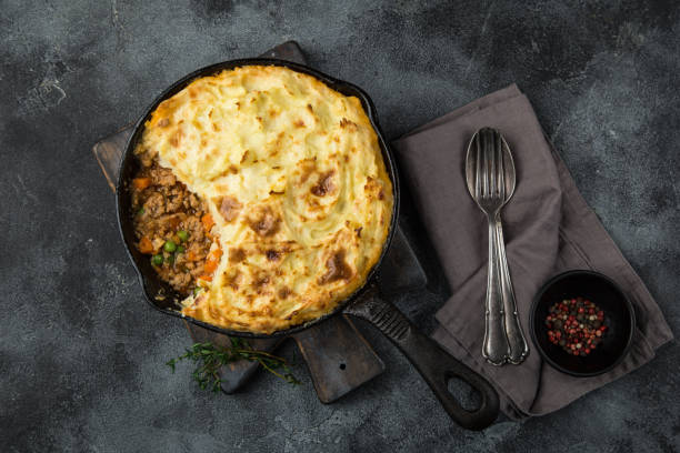 shepherd's pie. Minced meat, mashed potatoes and vegetables casserole in cast iron pan stock photo