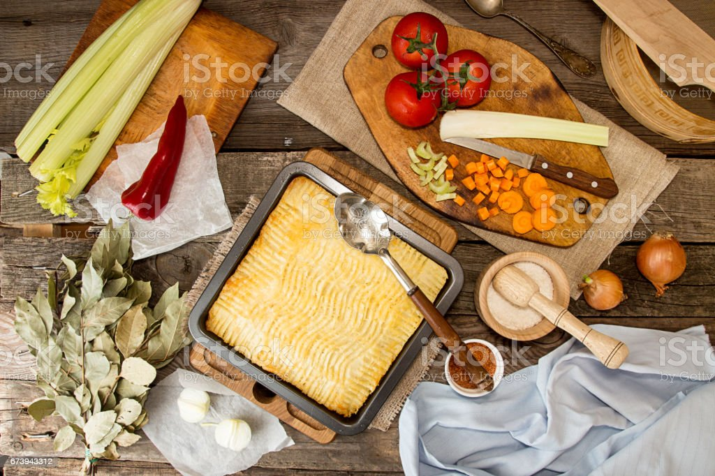 Shepherd's pie traditional english dish. Recipe with minced beef, lamb, carrot, onion, celery, mashed potato baked in casserole. stock photo