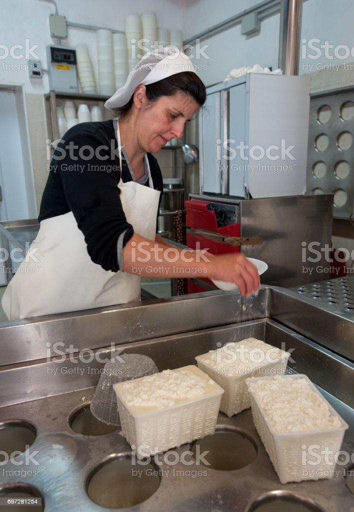 Shepherds prepare ricotta cheese with fresh sheep's milk stock photo