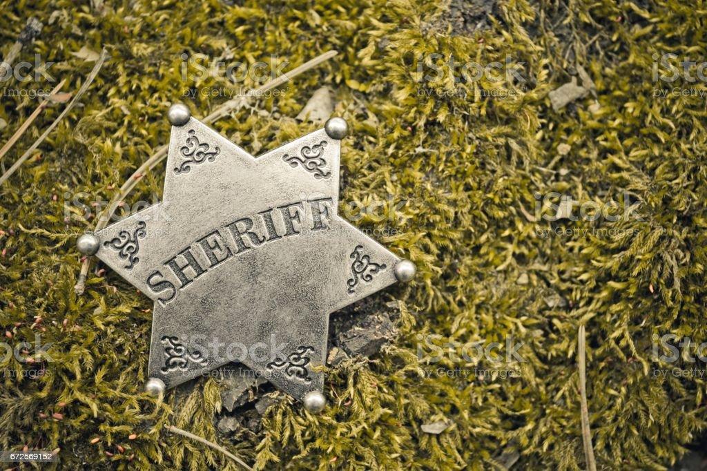 Sheriff badge on wooden background. stock photo