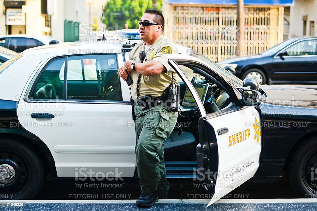 LA Sheriff coming out of the car on Hollywood Boulevard stock photo