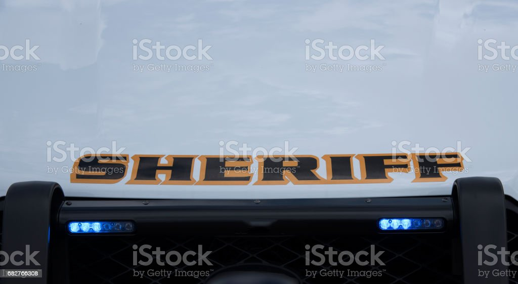 Sheriff vehicle with blue grill lights stock photo