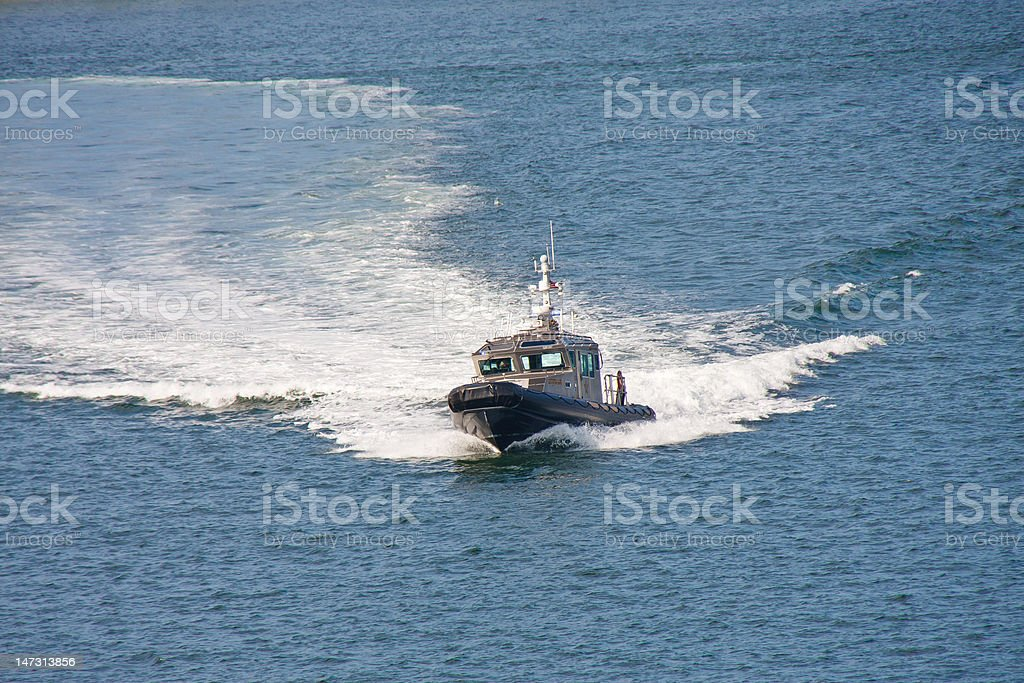 Sheriffs Boat Cruising Through Blue Water stock photo