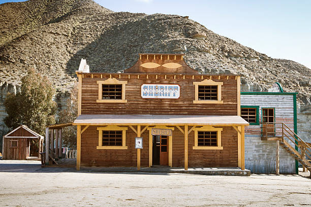 a sheriffs building in a wild west town - western town stock photos and pictures