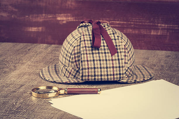 Sherlock Hat and magnifying glass Deerstalker or Sherlock Hat and magnifying glass on Old Wooden table. sherlock holmes stock pictures, royalty-free photos & images
