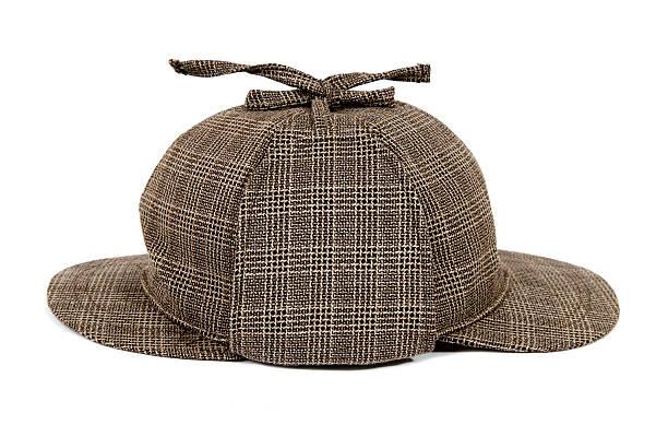 Sherlock Holmes Hat called deerstalker This is a Sherlock Holmes hat. Famous detective always carried this cap. deerstalker hat stock pictures, royalty-free photos & images