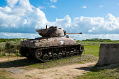 A Sherman tank from World War II is permanently on display at Utah Beach, which was one location for the large American D-Day landing in Normandy, France, on 6 June 1944