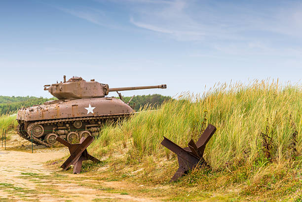 sherman tank a ww2 sherman tank on utah beach normandy. normandy stock pictures, royalty-free photos & images
