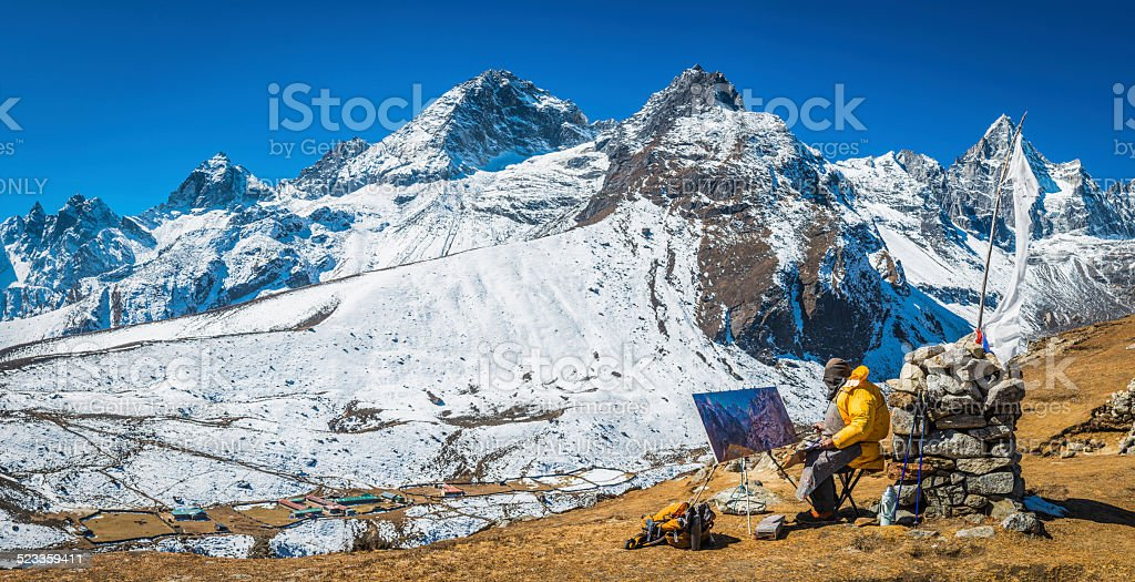 Sherpa artist painting remote Himalaya mountain peaks panorama Nepal stock photo