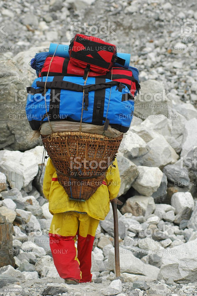 Sherpa carrying equipment to the Everest base camp stock photo