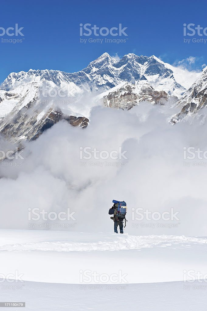 Sherpa mountaineer climbing below Mt Everest mountain summit Himalayas Nepal stock photo