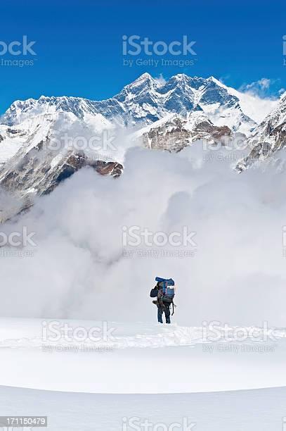 Photo of Sherpa mountaineer climbing below Mt Everest mountain summit Himalayas Nepal
